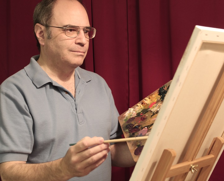 photo of artist painting at his easel