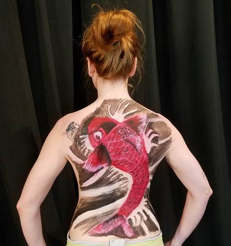 painting of Koi fish on back of female nude
