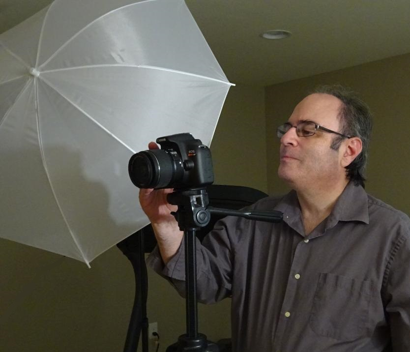 Peter standing behind camera and light reflector